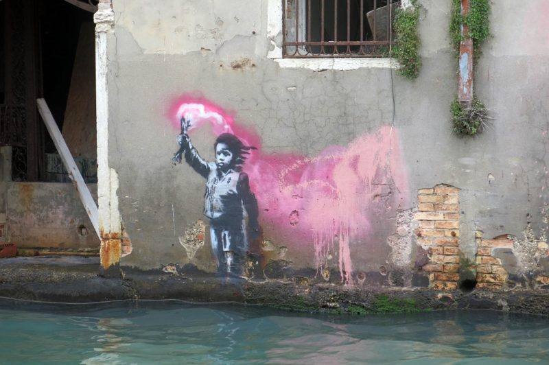 Stencil of a young migrant holding a flare could be the work of Banksy