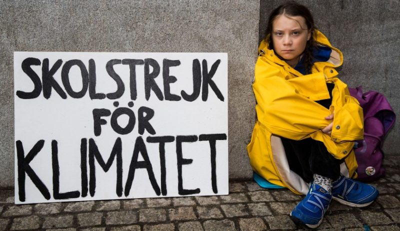 Greta Thunberg striking outside parliament