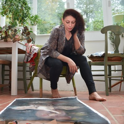 Iva Troj sitting in her studio