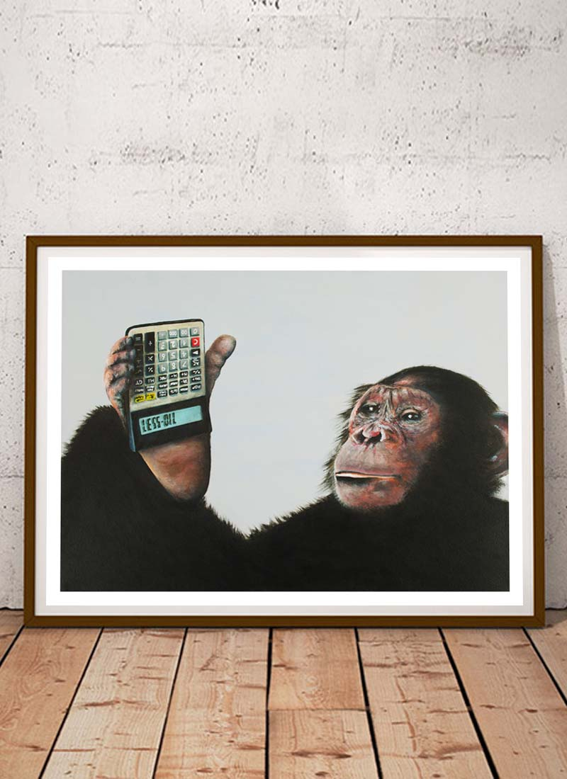 Chimpanzee holding a calculator upside down that spells out less oil in protest to the destruction of their habitat to make way for palm oil production