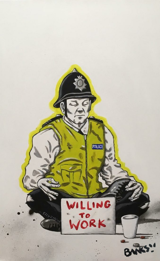 This art work shows a sleeping policeman with the sign 'willing to work'