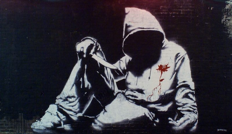 The hooded youth piece signed by Banksy. This appeared at the Cans Festival in London 2008