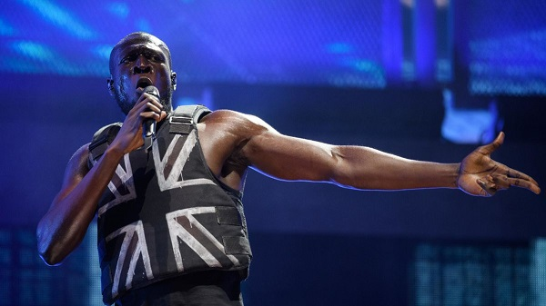 Glastonbury headlining grime artist Stormzy with the Banksy stab vest