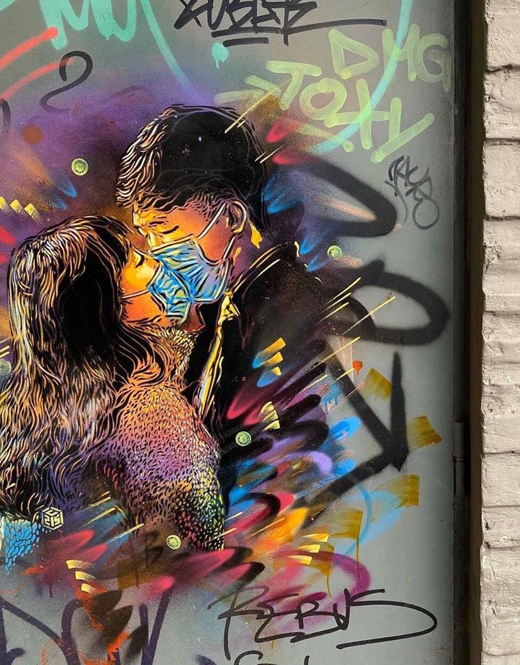 C215 depicts a loving couple wearing face masks