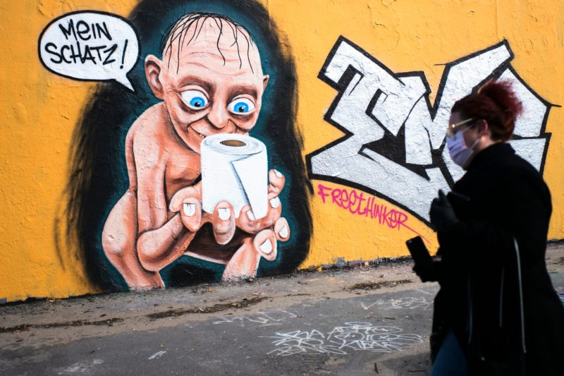 German street art depicts Golem staring longingly at a toilet roll