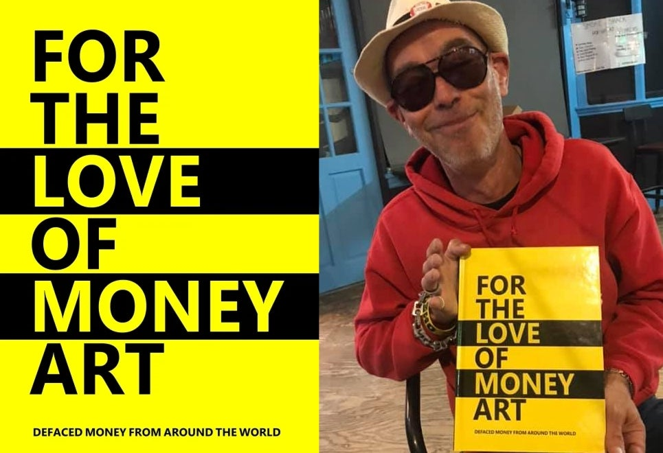Darren Main proudly holds his book 'For The Love Of Money Art'