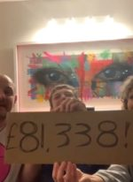Noah, aka Background Bob with his mum and dad reveal the grand total raised from the auction